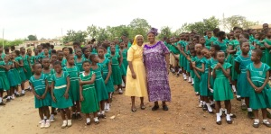 Rev. Sister Grace and MMVP with students of Atasemanso R/C Primary School