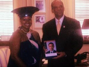 Premier_Dr._Ewart_Brown_receiving_Obamatyme_from_Poet_Melodye_Micere_VanPutten